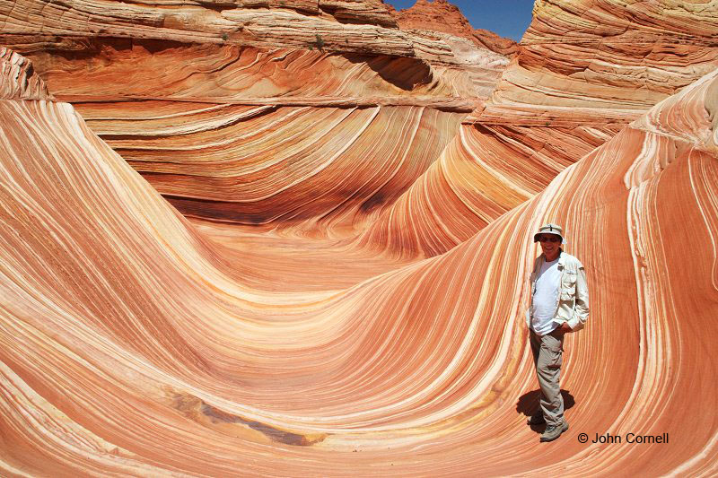 John Cornell in the Wave, a sandstone formation formed by wind and erosion in the North Coyote Buttes area of Vermillion Cliffs National Monument near  Grand Staircase Escalante National Monument.